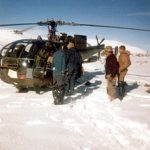Rescue operation for people trapped during heavy snowfall.